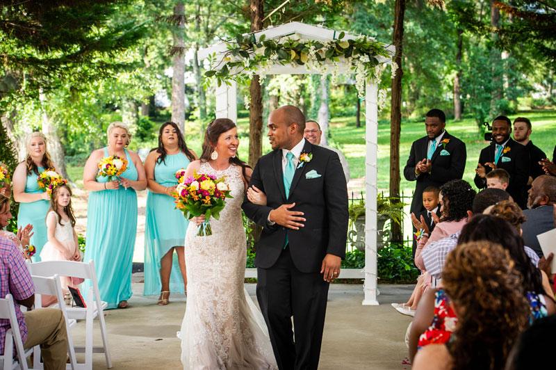 Wedding couple walking the aisle