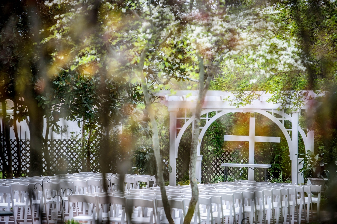 april arbor in garden with many chairs