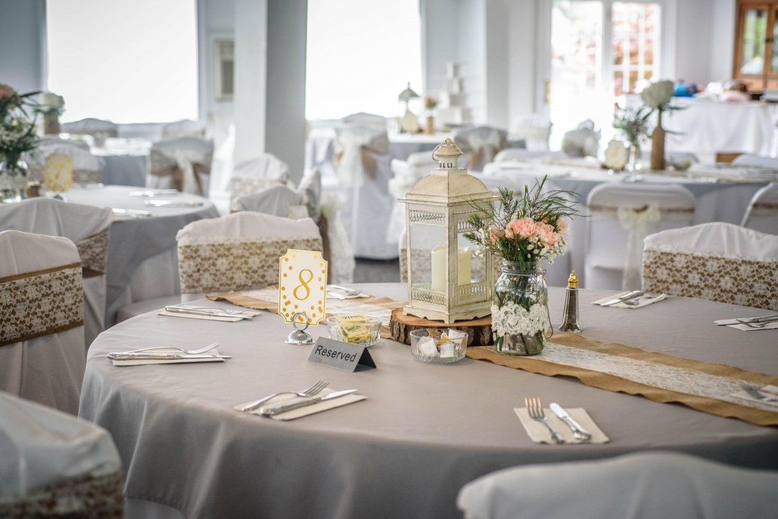 april hall tables with burlap and lace ties